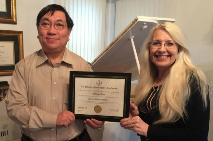 Anthony Tam receiving his UMTC Certificate